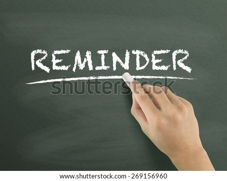 reminder word written by hand on blackboard - stock photo