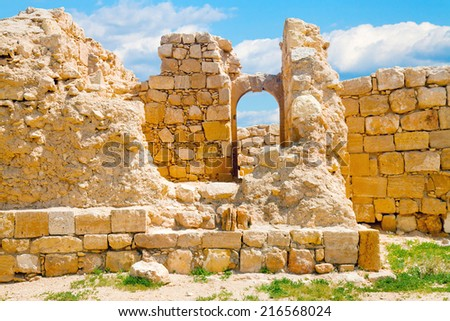 Remnants of an stone arch window in the ruined city of Mamshit, Israel - stock photo