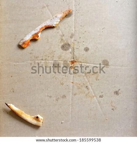 Remnants of pizza in a box  - stock photo