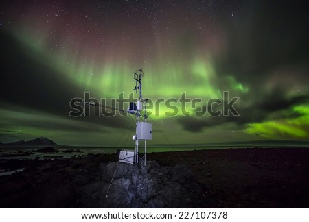 Remote Automatic Weather Station - Arctic, Spitsbergen - Northern Lights - stock photo