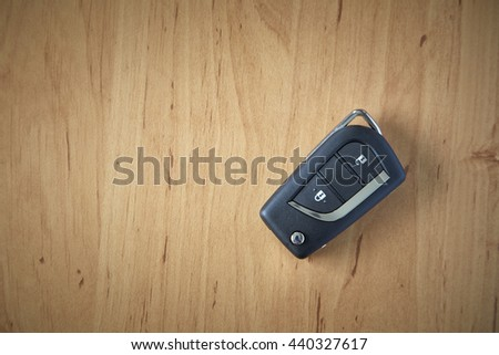 remote car key on wooden background