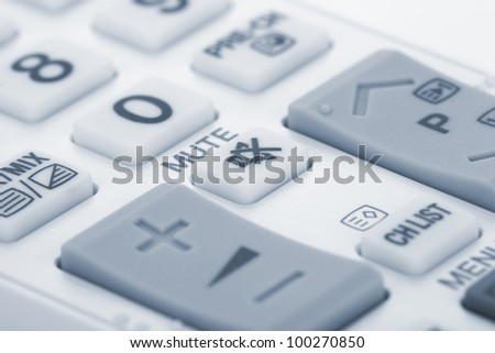 Remote control closeup. Focus on MUTE button - stock photo