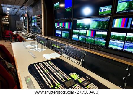 Remote control in a television studio - stock photo
