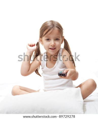 remote control in a young girl hand - stock photo