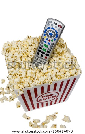 Remote Control In Bucket Of Popcorn/ On White Background/ Watching Movies At Home - stock photo