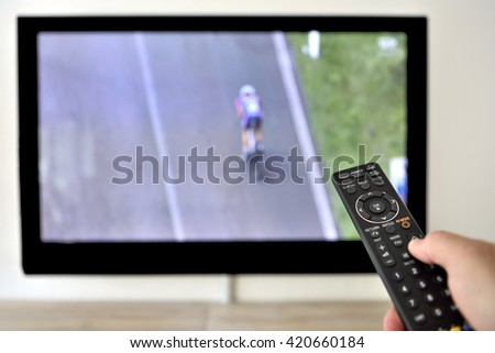 Remote Control in hand during TV Cycling