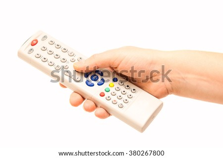 Remote control in hand on an isolated background