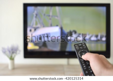 Remote Control in hand with Fishing Boats  on Screen