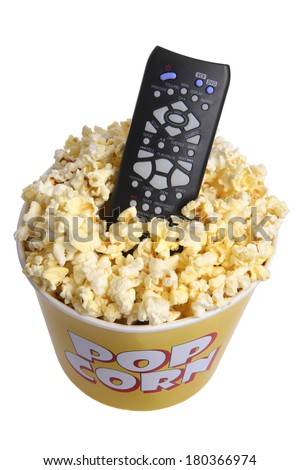 Remote control in popcorn bucket on white - stock photo