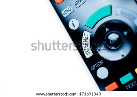 Remote control of a modern tv internet device with copy-space on the green large button for inserting provider name. - stock photo