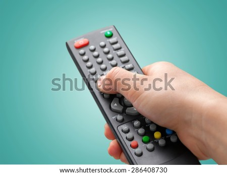 Remote Control, Television, Entertainment Center. - stock photo
