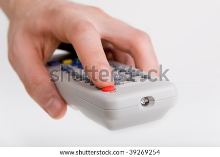Remote control tv in a hand - stock photo