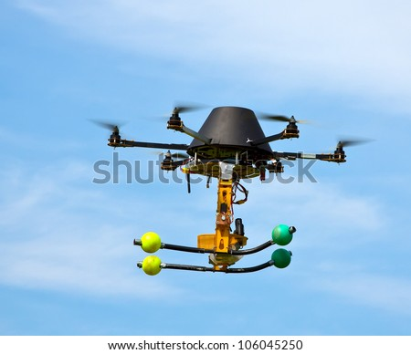 remote controlled flying craft with four motors - stock photo