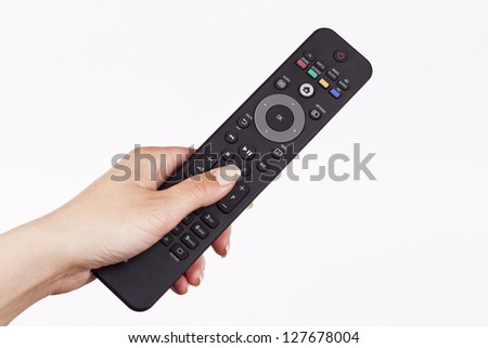 remote controller in a woman hand - stock photo