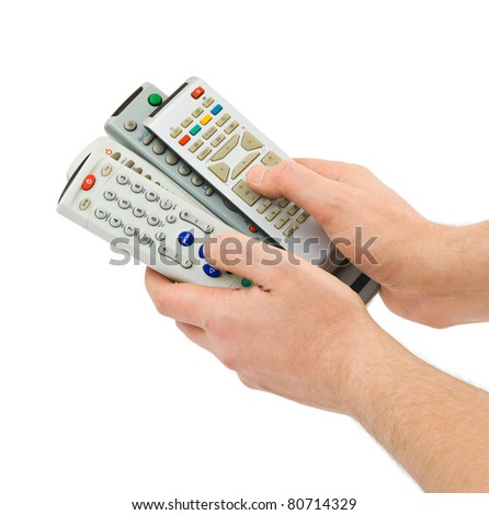 Remote controls in hands isolated on white background - stock photo