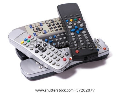 remote controls on white background - stock photo