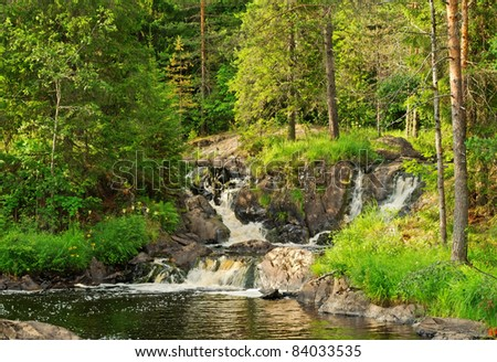 remote forest waterfall in sunny day