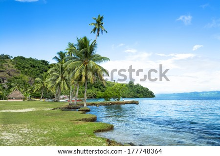 Remote Kioa Island in Fiji is a polynesian community that welcomes tourists and summer travelers from cruise ships and other local resorts.  - stock photo