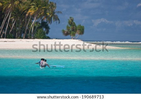 Remote Tropical Island With Locals in Dugout Canoe