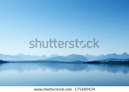 Remote view at the Atlantic Ocean Road, Norway. Misty mountain landscape in the hazy weather. - stock photo