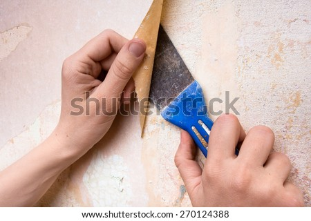 removal of old wallpapers from wall  - stock photo