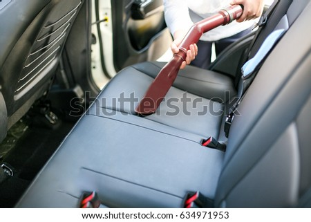 Remove Dust With A Vacuum Cleaner During Car Cleaning Wash