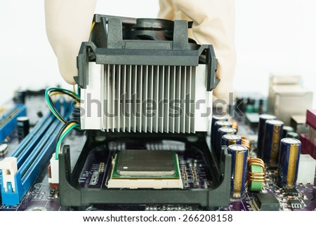 remove heat-sink from main-board with hand - stock photo
