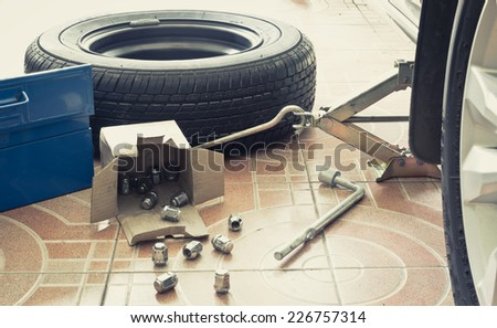 Remove, Install, replace Wheel tire nut for car & vehicle service concept / film processed - stock photo