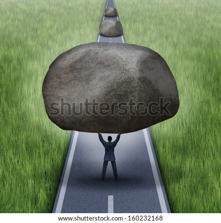 Removing obstacles business concept as a businessman clearing a path to success by removing large rocks on a road that are blocking the journey as a symbol of financial guidance and freedom. - stock photo
