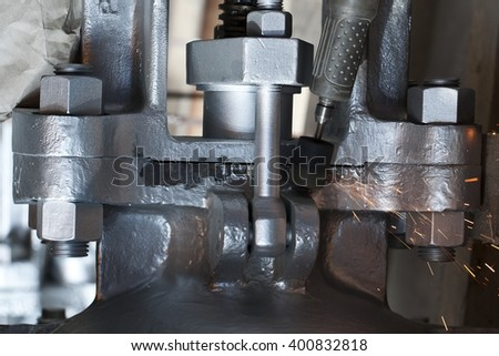 Removing of marking from valve body by grinding machine
