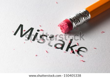 Removing word with pencil's eraser, Erasing mistake - stock photo