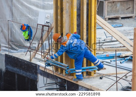 Renaissance construction workers reinforce fitting. The concrete foundation of the hotel building. Belarus,Minsk,Novem ber,1,2014