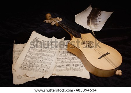 Renaissance lute (citole) with musical notes in retro style.