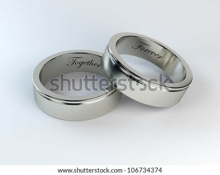 render of wedding rings with engraving - stock photo