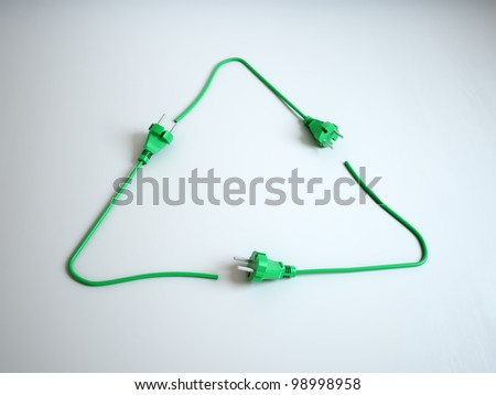 Renewable energy concept - recycling symbol power cords - stock photo