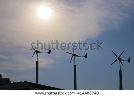 Renewable Energy concept. silhouette of wind turbines renewable energy against blue sky at dusk background - stock photo