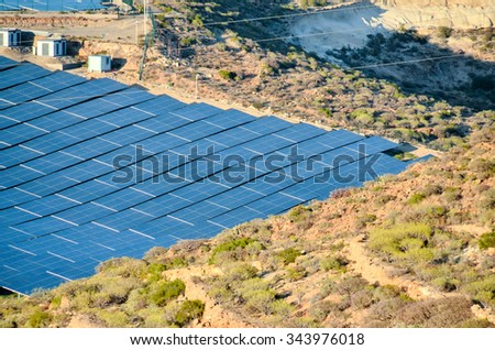 Renewable Energy Concept Solar Panels Field at Sunset