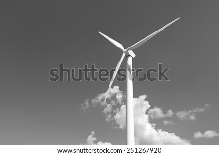 Renewable energy concept - wind generator turbines - stock photo