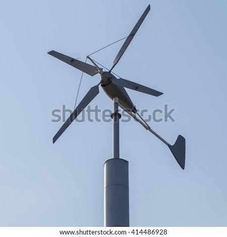 Renewable Energy concept. Wind turbine renewable energy against blue sky at dusk background - stock photo