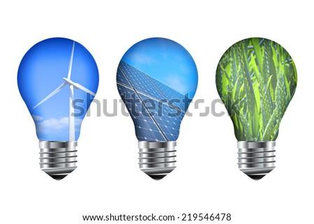 Renewable energy light bulbs. Solar panels, wind turbine and wheat field.  - stock photo