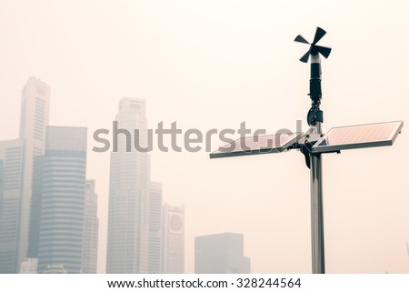 Renewable energy  Solar panels with wind turbine - stock photo