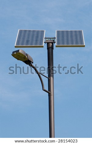 renewable energy streetlight on blue sky