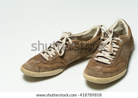 RENNINGEN, GERMANY - APRIL 30, 2016: Pair of men sports shoes from Rudolf Dassler on white background.