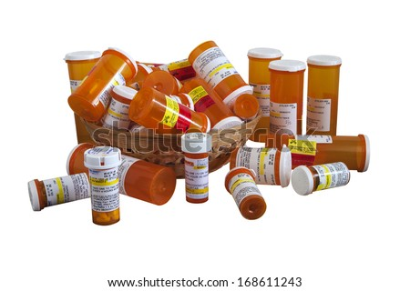 RENO, NEVADA-DECEMBER 23, 2013:  A collection of prescription pill containers representative of over medication prescribed by doctors in an effort to avoid possible law suits in a litigious society.