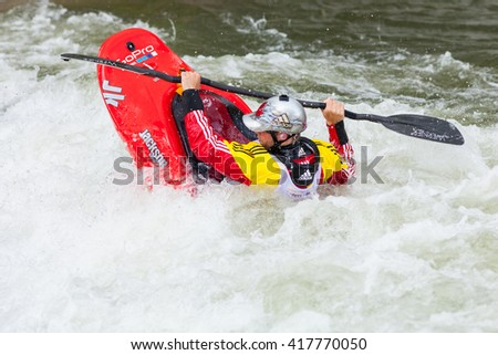 RENO, NV - MAY 7, 2016: Truckee River Whitewater Park in Downtown Reno. Competitor during freestyle kayak competition, Reno River Fest, May 7, 2016 in Reno, Nevada