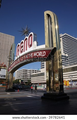 RENO - SEPTEMBER 22 : Gamblers arrive at the famous Virginia Street neon welcome sign September 22, 2008 in Reno. - stock photo