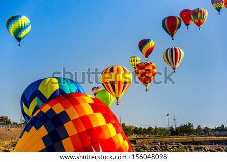 RENO - SEPTEMBER 7: Hot air balloons ascend in the morning sky to start the 38th annual Great Reno Balloon Race in Reno, Nevada on Sept. 7, 2013