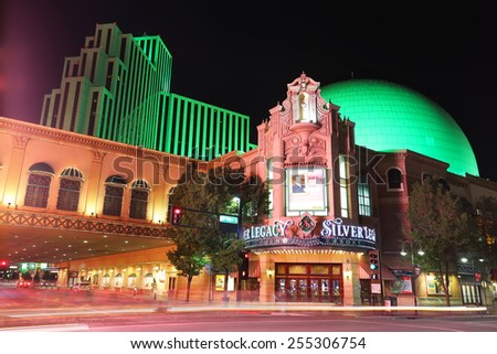 RENO, USA - AUGUST 12: Silver Legacy resort and casino at night with moving lights from passing traffic on August 12, 2014 in Reno, USA.  Reno is the most populous Nevada city outside of the Las Vegas - stock photo