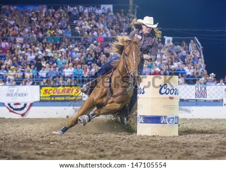 RENO , USA - JUNE 30 : Cowgirl Participant in a Barrel racing competition in Reno Rodeo a Professional Rodeo held in Reno Nevada , USA on June 30 2013  - stock photo