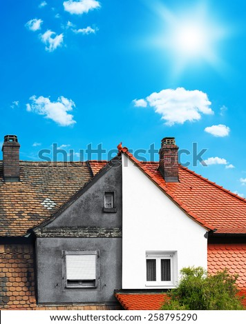Renovated and not renovated house side by side - thermal renovation concept - stock photo